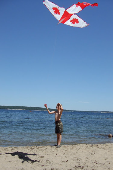 flying a kite on the beach at Killbear Provincial Park