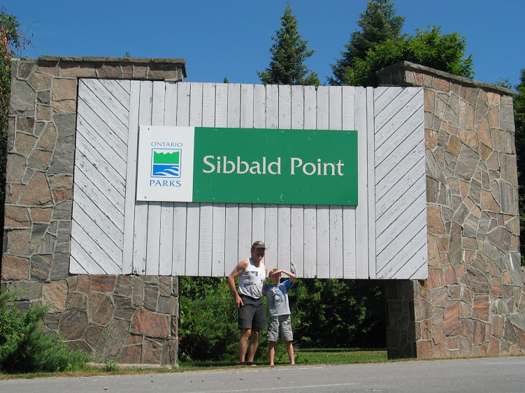 sign of sibbald point provincial park with two campers who are camping at sibbald point