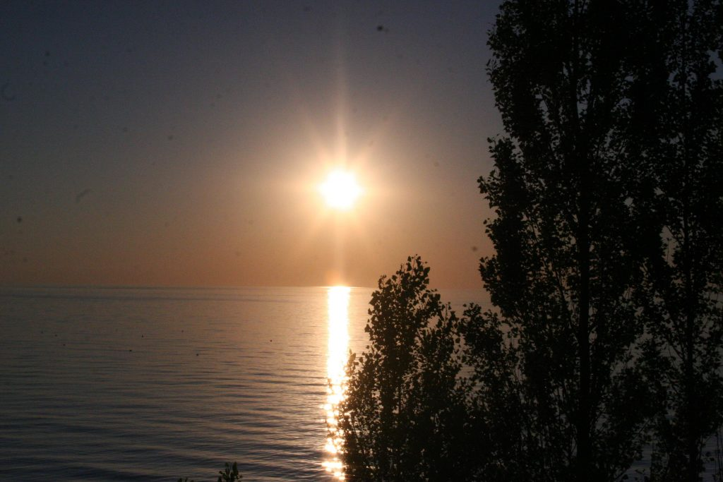 picture of the sun setting over the lake while camping at MacGregor Point Provincial Park