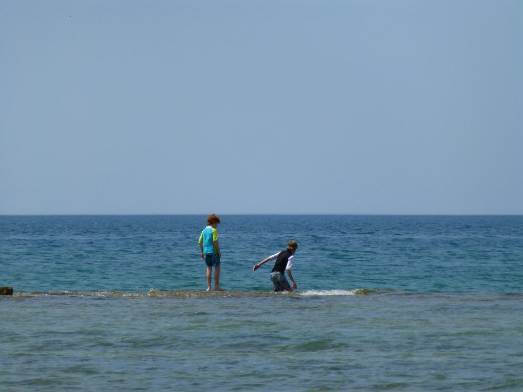 picture of kids in Lake Huron on the beach at Inverhuron Provincial Park