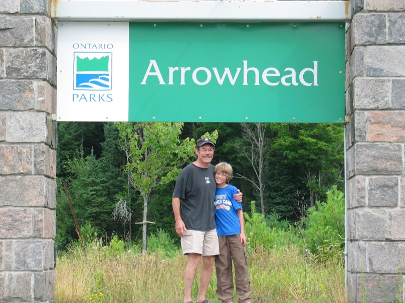 tim and thomas at the entrance to Arrowhead Provincial Park to go camping