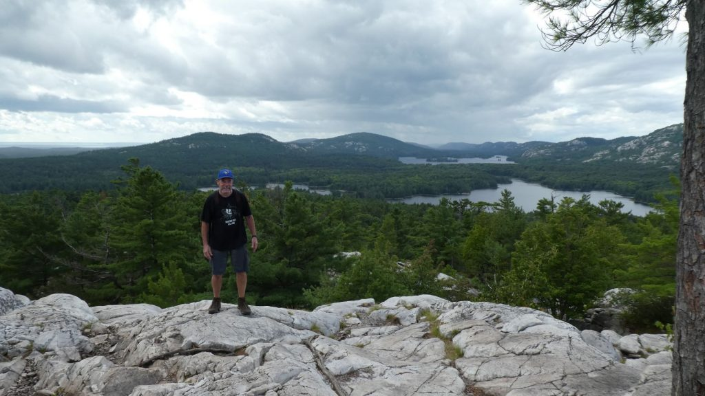 Tim standing on the white rocks at the top of The Crack at Killarney Provincial Park